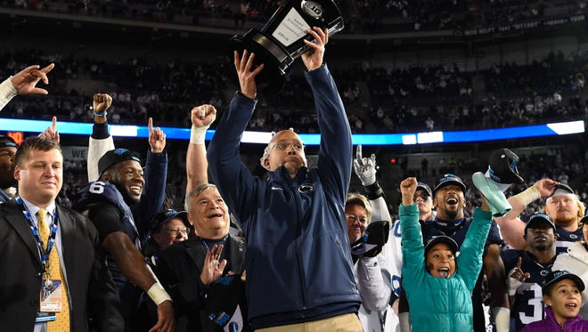 Penn State Nittany Lions head coach James Franklin holds the East Division Big Ten Championship Trophy following the game against the Michigan State Spartans at Beaver Stadium. The Nittany Lions won 45-12.