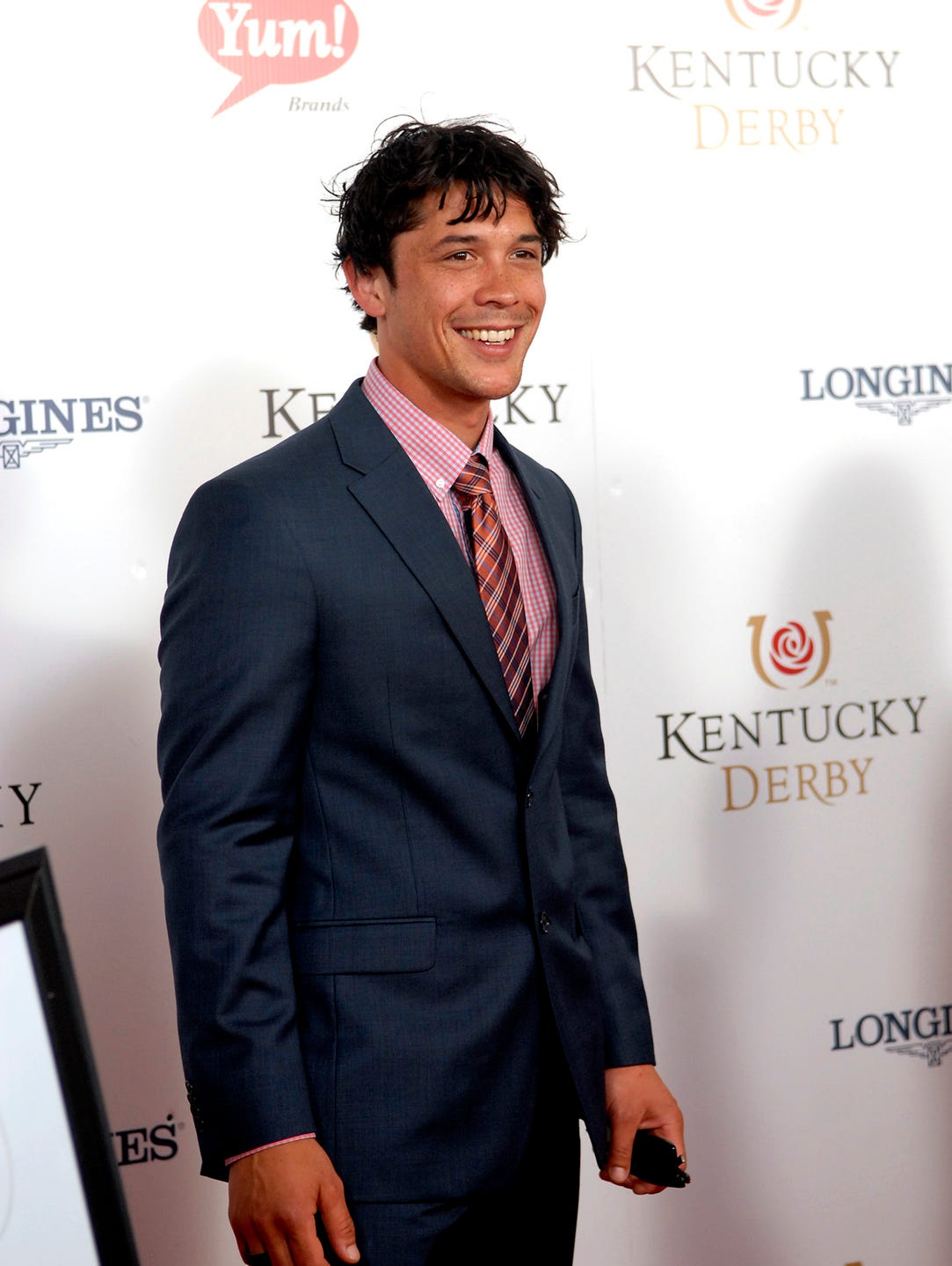 Actor Bob Marley from the CW's 100 poses for a photo on the Derby Red Carpet.  May 03, 2014
