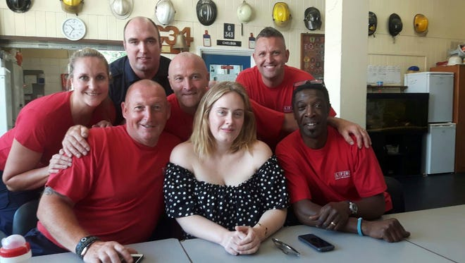 Adele paid a visit to first responders at Chelsea Fire Station, who battled the the Grenfell Tower blaze last week in west London.