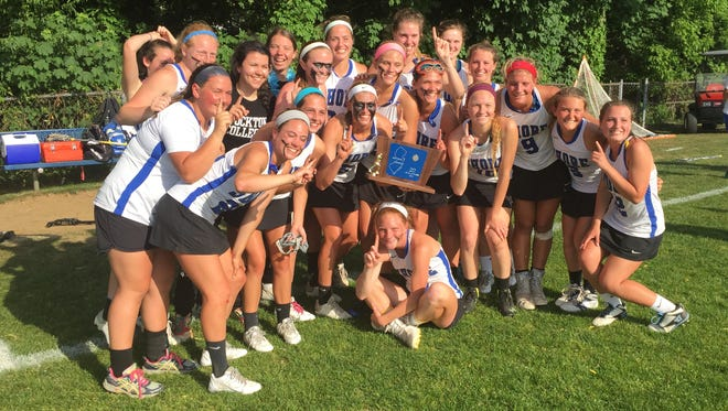 The Shore Regional girls lacrosse team celebrates winning the NJSIAA South Group I title on Wednesday afternoon.