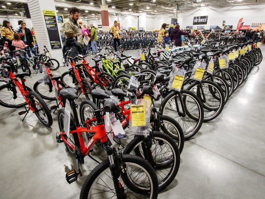 Cycling enthusiasts browse for the perfect ride during