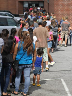 Kids and parents lined up outside Springfield Middle School for the Robertson County Mayor's Back to School Bash, held Saturday, July 30, 2016