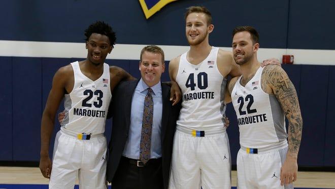 Marquette Men's head basketball coach Steve Wojciechowski poses with seniors Jajuan Johnson, Luke Fischer, and Katin Reinhardt.