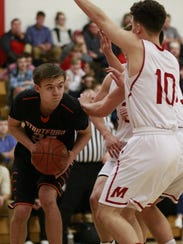 Stratford's Vaughn Breit,  left, looks for a pass while
