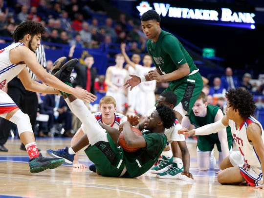 Trinity's Jamil Hardaway, center, comes up with a loose