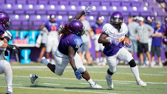 Northwestern State sophomore running back Jared West runs the ball during Saturday's practice.