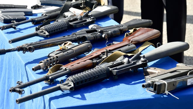 Seized guns on display during a live fire demonstration at the Essex County Police Academy in Cedar Grove on March 5, 2018.
