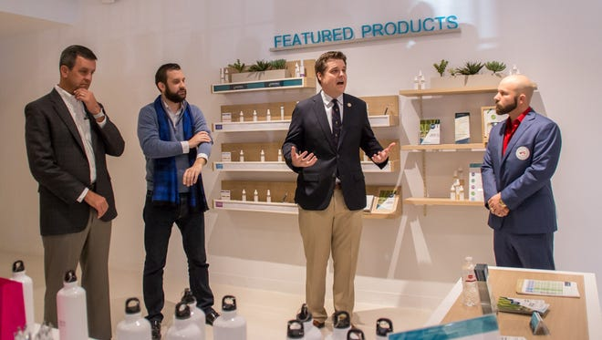 U.S. Rep. Matt Gaetz, R-Fort Walton Beach, second from right, talks Monday, Dec. 11, 2017, about his efforts to have medical marijuana reclassified from a Schedule I drug to a Schedule III drug during the grand opening of Surterra Wellness in Pensacola.