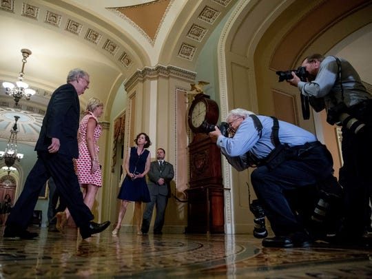 Senate Majority Leader Mitch McConnell walks to his office on Capitol Hill in Washington on Tuesday, July 25, 2017, after speaking on the Senate floor as he steers the Senate toward a crucial vote on the Republican health care bill.