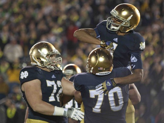 11/18/2012: Notre Dame's George Atkinson III celebrates with teammates after running in a touchdown during the game at Notre Dame Stadium on Saturday, November 17.
