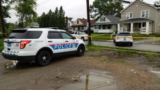 Columbus police vehicles and crime scene tape block off a homicide scene in South Linden in 2018.