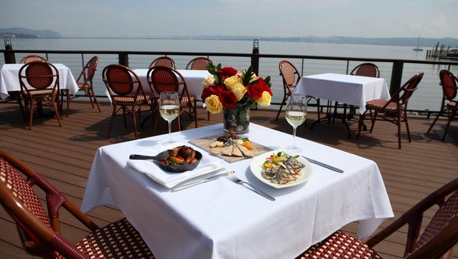 The outdoor patio at Pier 701 boasts Hudson River and Tappan Zee Bridge views.