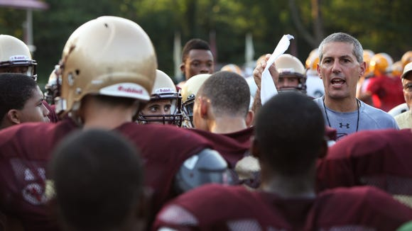 Iona Prep coach Vic Quirolo talks with his team during a football camp at Iona Prep in 2012. Quirolo, one of the most prominent coaches in the Lower Hudson Valley, resigned in 2015 but will return as an assistant coach.