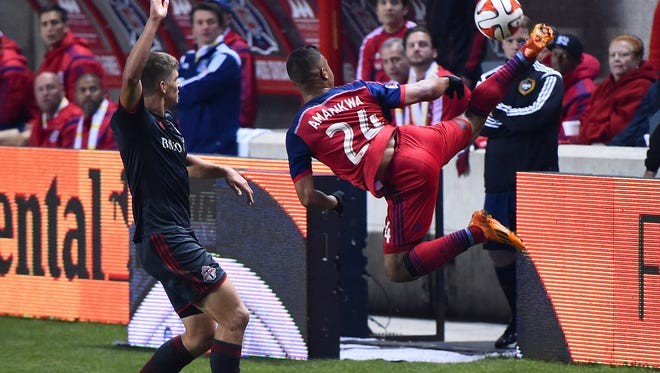Chicago Fire forward Quincy Amarikwa (24) kicks the ball against Toronto FC defender Nick Hagglund (17) during the first half at Toyota Park.