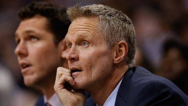 Head coach Steve Kerr of the Golden State Warriors watches from the bench during the first half of the NBA game against the Phoenix Suns at Talking Stick Resort Arena on February 10, 2016 in Phoenix, Arizona.