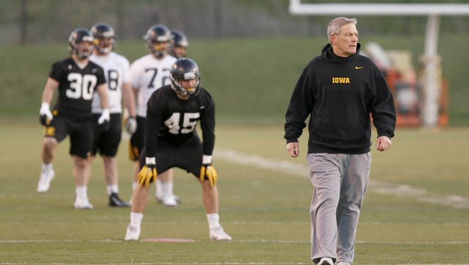 Head football coach Kirk Ferentz leads his players through drills Friday, April 8, 2016, during the Haweye's open practice at Valley Stadium in West Des Moines.