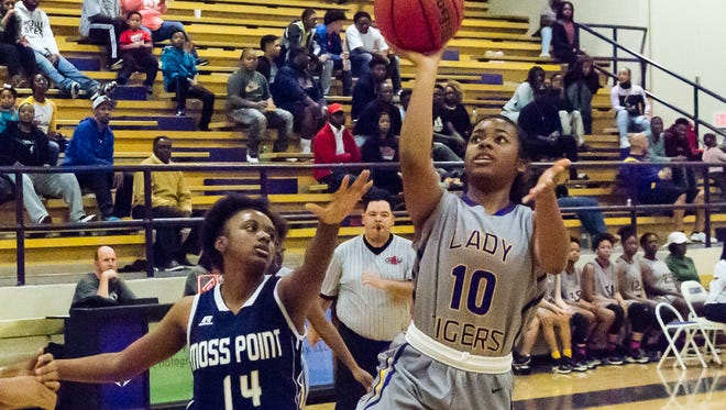 Hattiesburg's Chelsea Ulmer goes for a layup during the Lady Tigers' game against Moss Point.