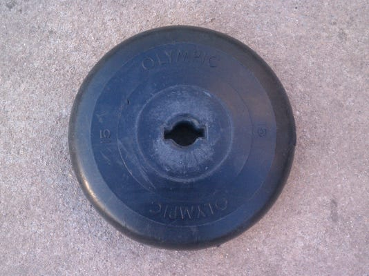 """Like"" if you know what this is. OK, so this isn't Facebook. There's no ""like"" button. But let's play the FB nostalgia game. Do you know what this is? It's a 15-pound weight from my very old barbell set, circa 1975 or so."