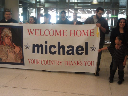 The family of Michael Collazo, of York, stands at BWI airport to welcome the soldier home from Afghanistan. Shortly after this picture, family realized they were waiting at the wrong spot.