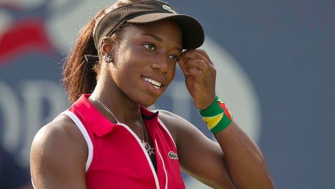 Sachia Vickery reacts in her match against Julia Glushko on Day Four of the 2013 US Open at the Billie Jean King National Ten