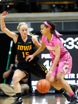 Ashley Morrissette works to get past Whitney Jennings of Iowa during the Boilermakers' 90-73 victory at Mackey Arena on January 24.
