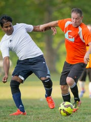 Ajay Mundlur of Ithaca, left, playing for 2nami, works