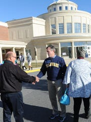 Now-Gov. John Carney meets voters outside Cape Henlopen High School on Election Day in 2016.