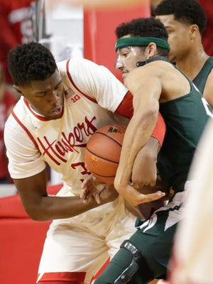 Michigan State's Kenny Goins, right, fouls Nebraska's Jordy Tshimanga (32) as they struggle for the ball during the first half of an NCAA college basketball game in Lincoln, Neb., Thursday, Feb. 2, 2017. (AP Photo/Nati Harnik)