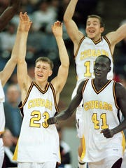 Bloomington North players David McKinney, left, Jeremy Sinsabaugh and Kueth Duany celebrate their state championship victory over Delta Saturday night at the RCA Dome.  (Steve Healey/Staff Photo)3/22/97