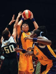 Zheng Haixia takes a shot over New York Liberty star Rebecca Lobo (left) while Lisa Leslie, her Los Angeles Sparks teammate, positions herself for a rebound in the WNBA's inaugural game in Inglewood, Calif., on June 21, 1997.