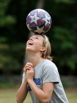 Dover-Sherborn High School senior Hope Shue practices soccer in her backyard. She's a two-sport standout for the Raiders and will move on to play lacrosse at Middlebury College.