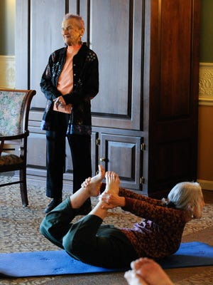 Mabes Morrill instructs her yoga class at Westminster Village in Dover. Mabes, age 93, started yoga because she had arthritis.