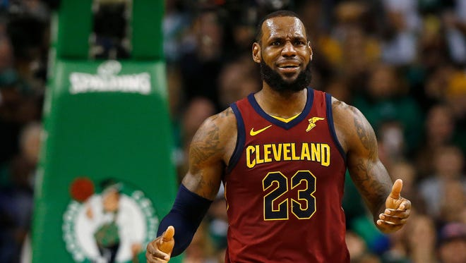 Cleveland Cavaliers forward LeBron James (23) reacts to not getting a foul called during the third quarter of the Eastern conference finals of the 2018 NBA Playoffs against the Boston Celtics at TD Garden.