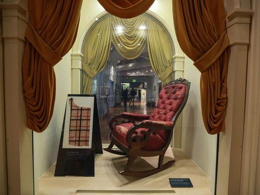 The upholstered seat rocking chair in which President