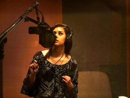 Artist Jena Irene during a recording session at Studio