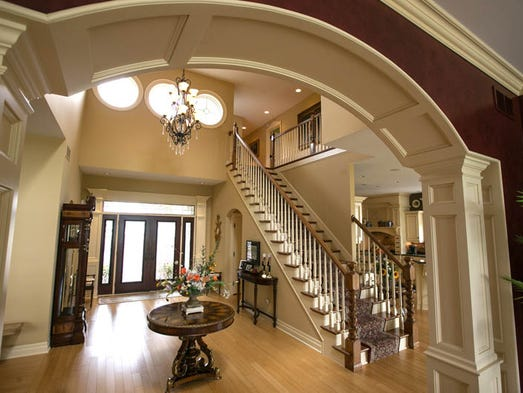Dining room with a staircase leading to the second floor ryan garza