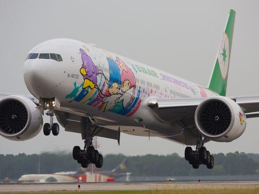 EVA Air's newest Hello Kitty Boeing 777-300ER jet lands
