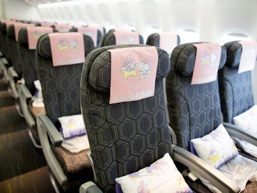 A sea of Hello Kitty themed headrest covers extends