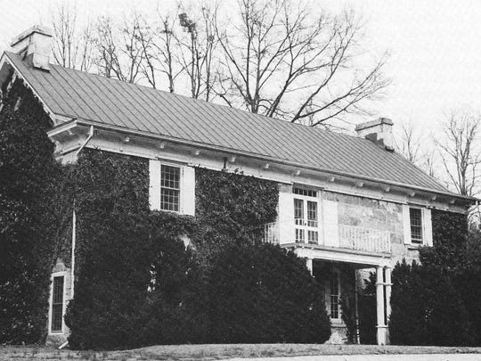 The Rock House on Buncombe Road (not far from the University Square Shopping Center) has been a stagecoach inn, a post office, and a school for girls as well as a family home for nearly a century. (Photo by Bob Bainbridge)
