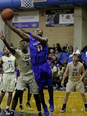 TCC guard David Simmons goes for a lay-up during the 2016 Tallahassee Democrat Holiday Classic game against Northeast Mississippi Community College Dec 30.