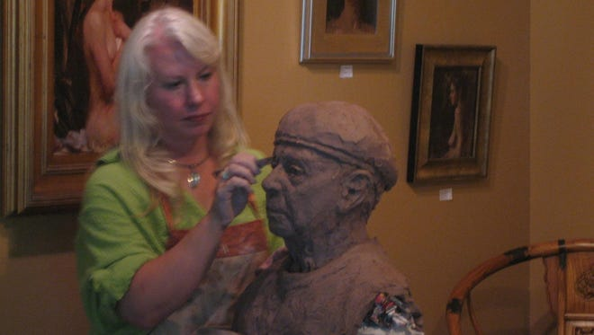 Sculptor Bren Sibilsky of Algoma, shown giving a demonstration, was named the judge for a second straight year of the Best of Sculpture Award in the Manhattan Arts International HerStory online competition and exhibit.