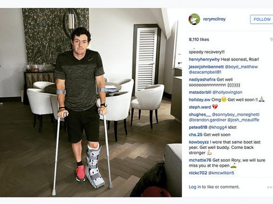 This image released Monday by world No. 1 golfer Rory McIlroy shows him as he poses on crutches and with his left leg in a medical support. McIlroy ruptured a ligament in his left ankle while playing soccer less than two weeks before the start of his British Open title defense. The Northern Irish golfer announced Wednesday that he would miss this year's British Open.