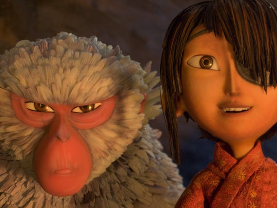 Kubo, voiced by Art Parkinson, right, and Monkey, voiced