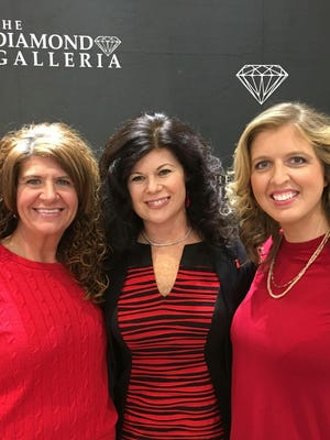 Go Red – The Go Red Premiere, sponsored by the Diamond Galleria and held at their beautiful shop, marked the official kick-off of the 5th Annual Go Red for Women luncheon, benefiting the American Heart Association. Guests dropped in for hors d'oeuvres and beverages and a chance to win a gorgeous Hearts on Fire necklace. In the photo are Maria Evans and Jennifer Hickey, co-chairs of the Passion Committee and Malissa Troutman, Director Southwest Indiana Heart Association.