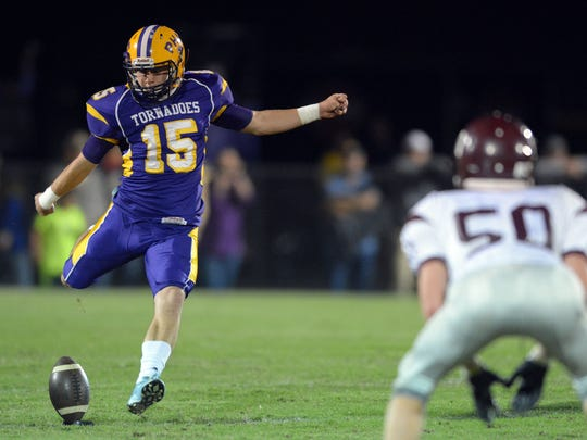 Purvis player Brady Farlow (15) kicks off during a game against Forrest County at Purvis High School Friday, Oct. 30.