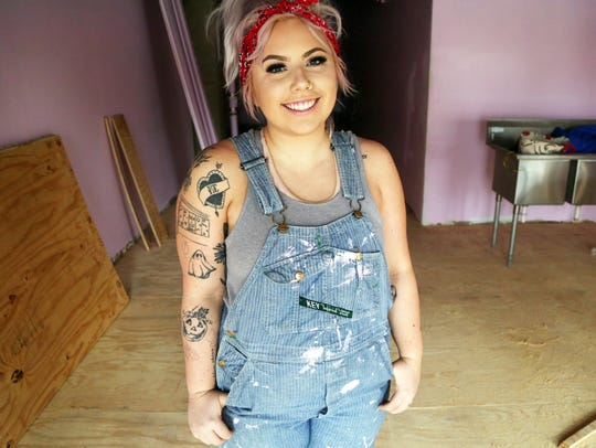 Nicole Leth, 23 and a Des Moines native, stands inside