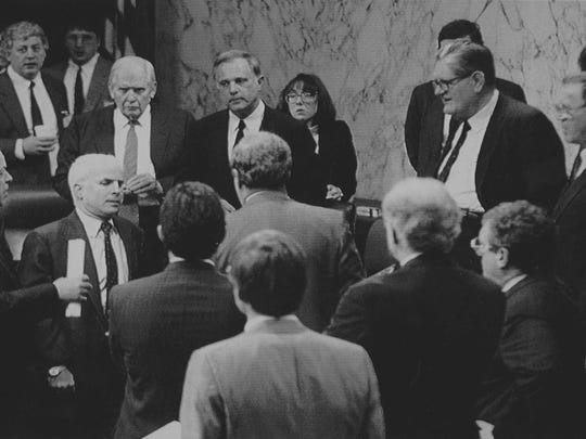 Attorneys and Senator John McCain, of Arizona, confer with members of the Senate Ethics Committee during a break of the proceedings to decide the order of the appearance of accused senators before the committee. McCain and four other senators are accused of improperly intervening with federal banking regulators on former savings and loan owner Charles H. Keating Jr.