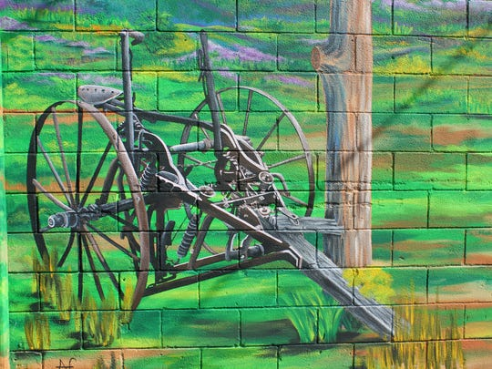 """A catapult is painted into the """"Colors of Our Past"""" mural."""
