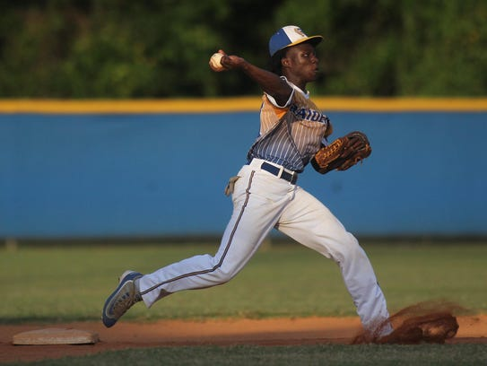 Rickards shortstop Ferante Cowart fields a ball on the second base side of the diamond and fires to first for an out during a game against Florida High.
