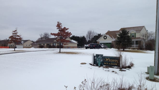 A home in the Whispering Meadows subdivision of Hartland Township was broken into and a couple inside the residence were attacked over the weekend.